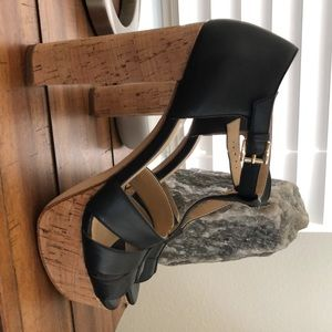 Michaeh Kors black strap leather high heeled